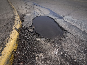 Pothole road damage